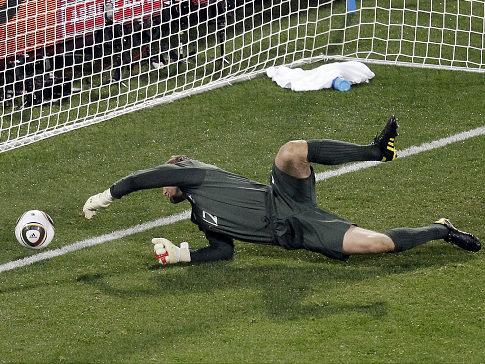 Shot bounces off Robert Green's hands and into the net in the U.S. vs. England's 1-1 tie. (Sohn/AP Robert)